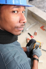 Electrician with an ampmeter