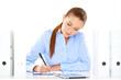 Efficient businesswoman working at her desk