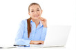 Smiling businesswoman working on a laptop