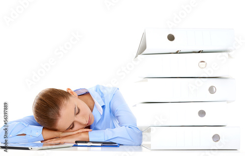 Tired businesswoman asleep at her desk