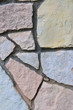 Stone fence background, vertical stonewall closeup, decorative