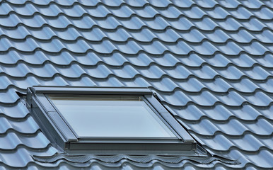 Roof window on a grey tiled rooftop large detailed loft skylight