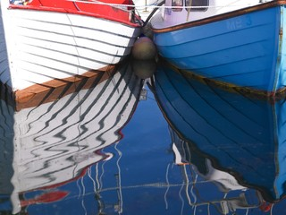 reflection of boats in water