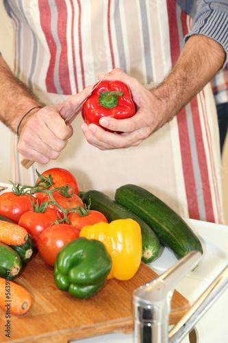 Man preparing red pepper