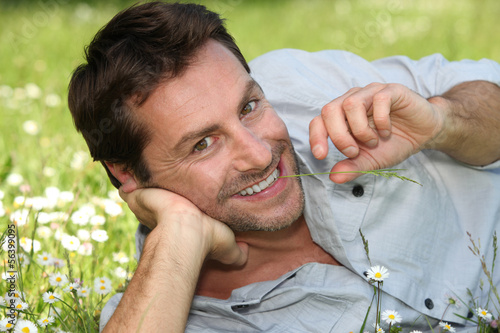 Man laying in field