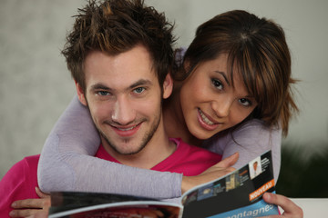 Couple reading magazine
