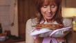 Mature woman smelling a pie she has just cooked