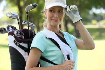 A smiling female golfer.