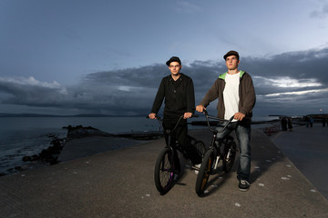 Two Young men with bicycles
