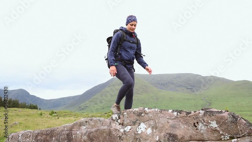 Fit woman reaching the summit and looking around