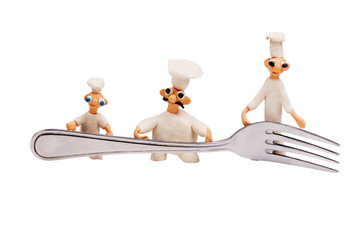 three little cheerful chef made from clay