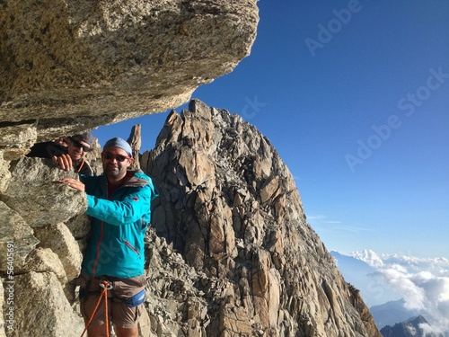 Alpinist reaching summit