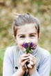 Little girl holding flowers and smileing