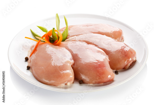 Raw chicken breasts on white background