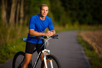 Healthy lifestyle - young man biking