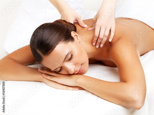 Foto op Canvas Spa Massage. Close-up of a Beautiful Woman Getting Spa Treatment