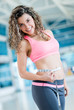 Gym woman measuring her waist