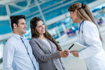 Doctor handshaking a couple