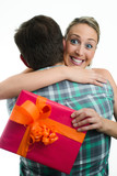 young casual couple with gift