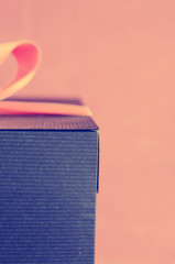 vintage grunge present box and ribbon on pink background