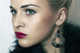 beautiful blond woman.Jewelry and Beauty.red lips.close-up