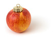 Festive apple with christmas ornament