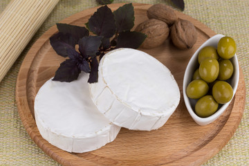 cheese platter with  nuts and  grapes and olives