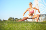 woman stretching hamstring leg muscles during outdoor running wo poster