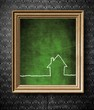 Home icon symbol with copy-space chalkboard in old wooden frame