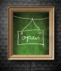 Open sign chalkboard in old wooden frame