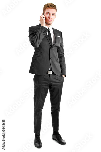 Businessman on the phone full length