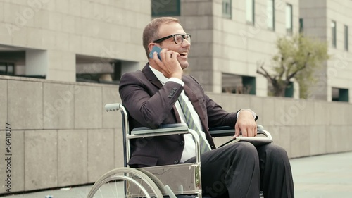 4of15 Health and handicap, business people on wheelchair