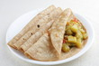 Постер, плакат: Vegetarian sandwich chapati with cooked vegetables