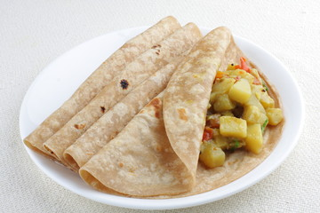 Vegetarian sandwich, chapati with cooked vegetables.