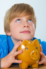 boy and his piggybank
