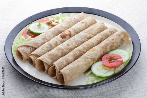 Indian flat-bread called chapati rollswith vegetable .