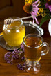 Still life from medicinal herbs, honey, herbal tea on a wooden