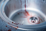 Close-up shot of bloody kitchen sink