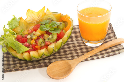 fruit salad in the melon fruit with orange , fusion food