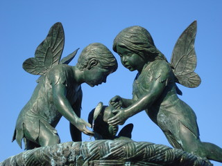 Statue of winged little girl and boy