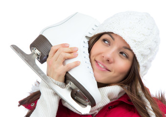 woman holding ice skates for winter ice skating sport