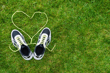 Sneakers on grass with heart