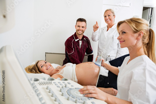 Couple And Doctors Looking At Ultrasound