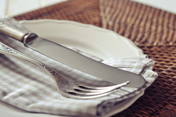 White plate, fork and knife