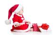 christmas baby girl opening gift box isolated on white backgroun