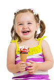 happy kid girl eating ice cream in studio isolated