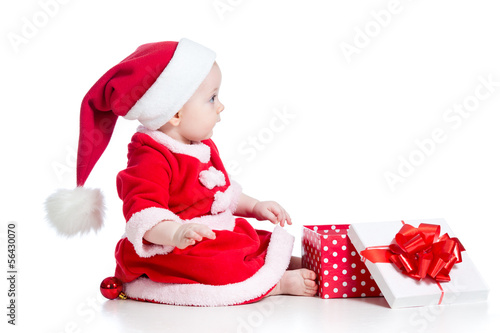 christmas baby girl opening gift box isolated on white backgroun