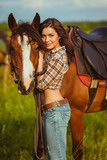 beautiful woman standing near a horse