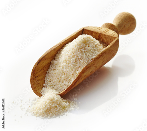 wooden scoop with semolina croup