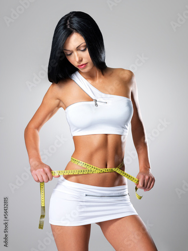 Slim  woman and measure tape